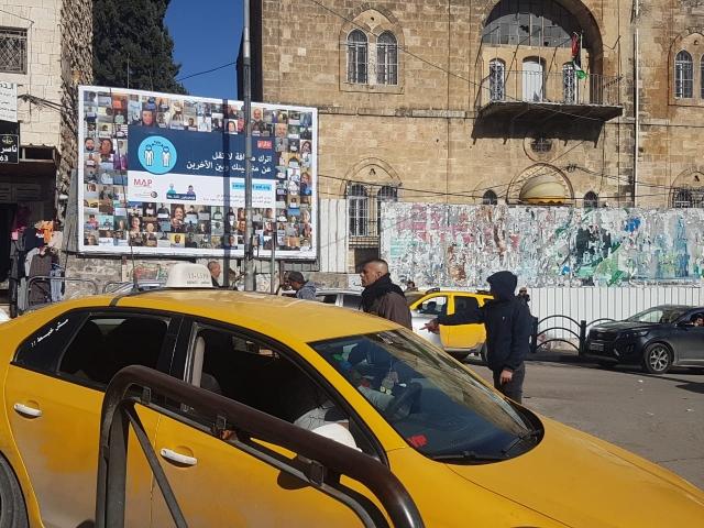 The #IsolatedButTogether billboard in Hebron